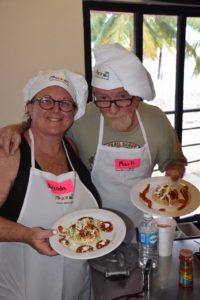 Mark and Brenda in a cooking class in Cozumel. 2016
